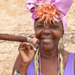 woman-with-typical-clothes-and-a-huge-cuban-cigar-in-havana-cuba-651x434